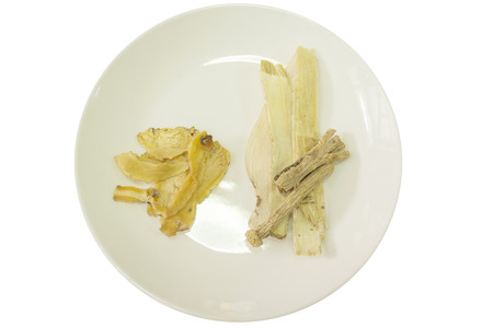 chinese herbs: chinese herbs in white plate with white background. Stock Photo