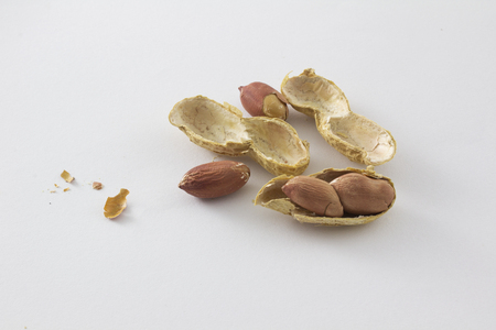 earthnut: Roasted peanut with shell on white background. cracking nuts.