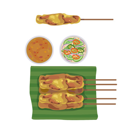 dipping: Satay on banana leaves and bowl with dipping sauce.