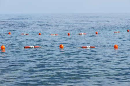 delimitation: Orange buoys at safe swimming zone in the sea Stock Photo