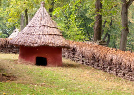 Mud hut with straw roof, fall picture Stock Photo