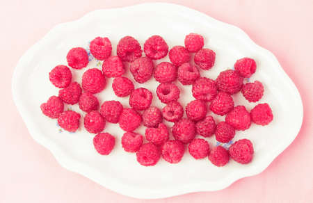 l plate: Fresh and delicious raspberries in a white plate