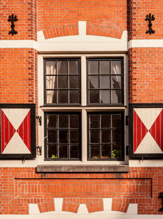 singular architecture: Traditional dutch window with shutters in Amsterdam