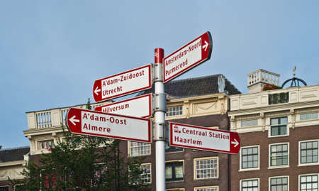 different way: Different way sign for tourist directions in Amsterdam Netherlands