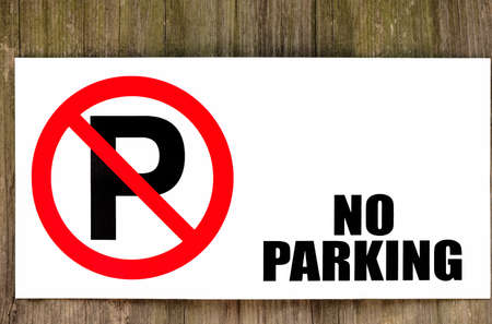 No parking sign on brown wooden background
