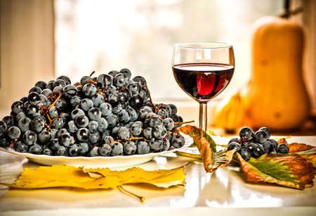 Glass of wine and grapes.Autumn fruits and drinks Stock Photo