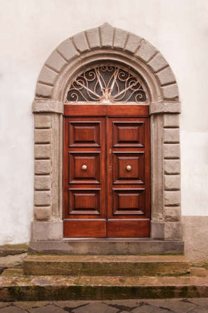 Picture with vintage brown wooden door and stone wall