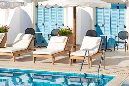 Sunbeds and umbrellas near the pool in a Greek resort