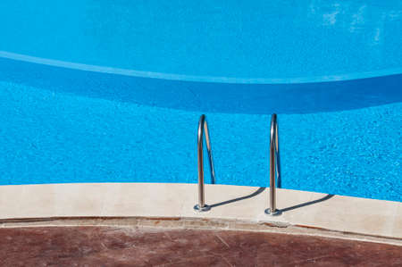 Beautiful empty swimming pool with blue water Stock Photo