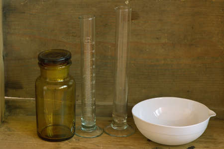 Vintage laboratory equipment reagent bottle evaporating dish and cylinders