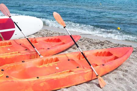 Kayaks on the beach by the sea Фото со стока
