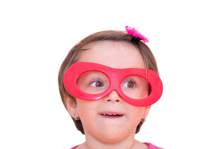 Portrait of a little girl wearing red plastic toy eyeglasses