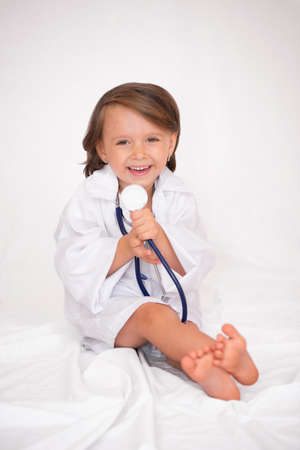 Little girl holding a stethoscope with clipping path Stock fotó - 135010936