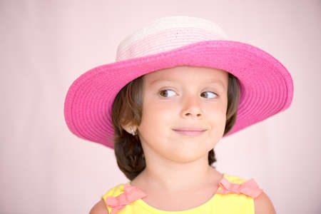 Little girl with pink hat isolated with clipping path Stock fotó - 135010947
