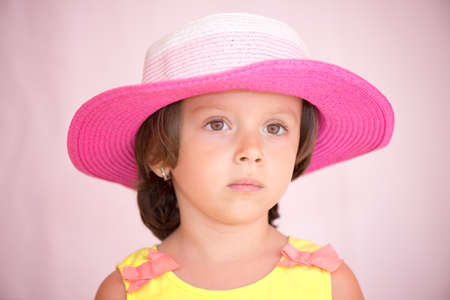 Little girl with pink hat isolated with clipping path