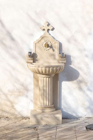 White vintage marble water fountain with cross Stock fotó - 135010968