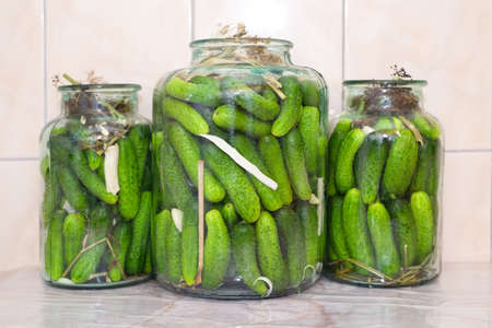 Cucumbers in jars ready to be pickled with spices and herbs Stock fotó - 135011022
