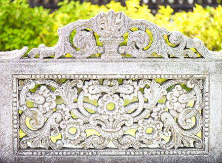 Carved stone fence with floral pattern outdoors