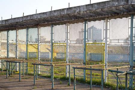 Old metallic fence near a abandoned stadium