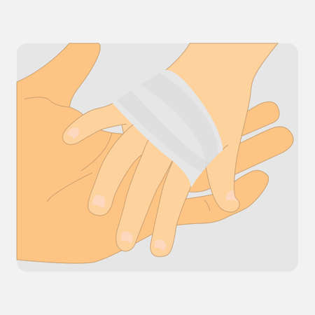 Hand holding an injured hand with bandage, empathy concept