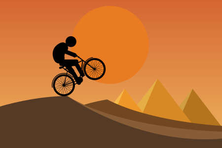 Silhouette of a young man with leg prosthesis riding a bike