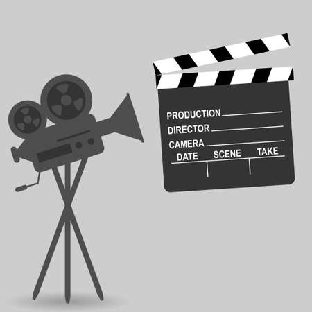 Vintage professional camera for movies and clapperboard