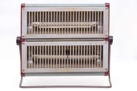 Old electric heater isolated on white background