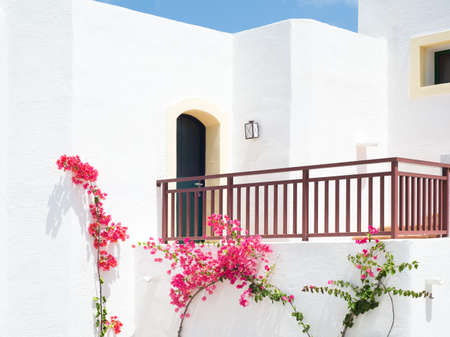 White balcony with bougainvillea outdoors in Greece