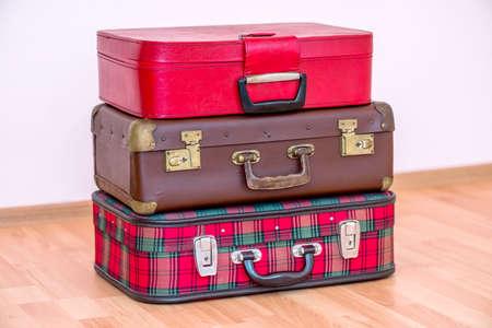 Three vintage suitcases isolated