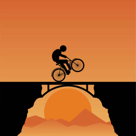 Silhouette of a young man riding a bike on a bridge