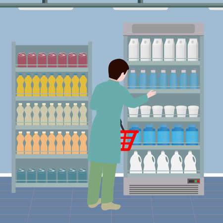 Person with a shopping basket near the supermarket shelves with drinks and dairy products