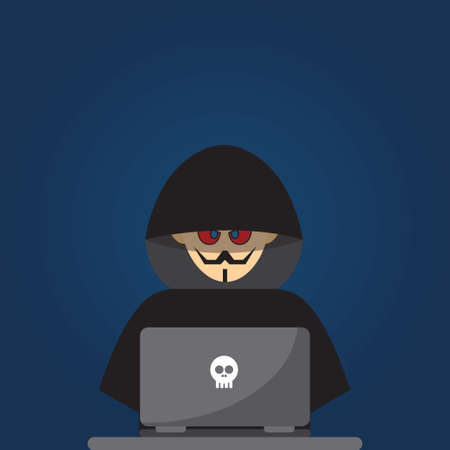 Hacker dressed in black in front of a laptop