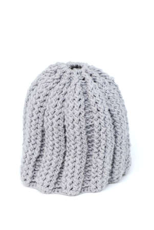 Knitted hat on white background photo