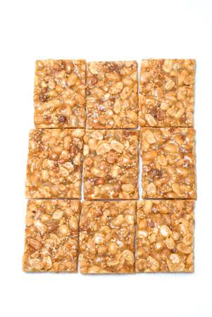 gozinaki: peanut candy on white background