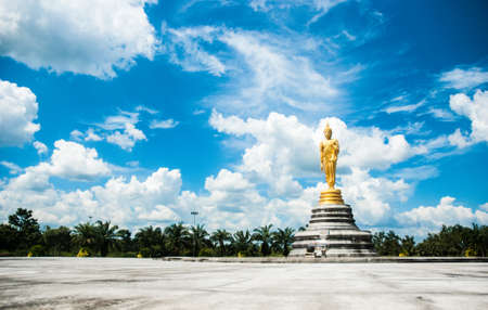 Big golden buddha statue with blue sky, Thailand  photo