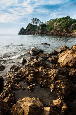 Rocky beach with sea water erosion