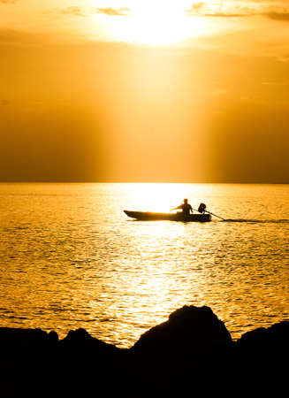 Long tail boat and sunset