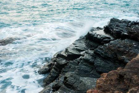 splashing wave on rocks