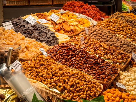 Dried fruit stand at the market La Boqueria, Barcelona