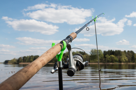 Fishing. Fishing rod is installed on the river bank in the Tver region. Russia.
