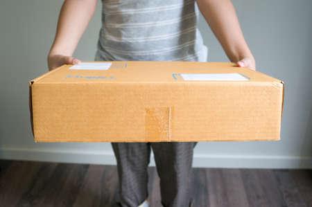 woman is sending a box