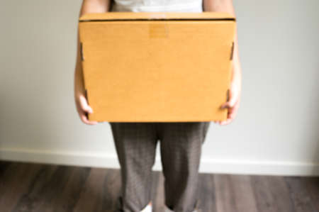 cardbox: blurred background delivery box , holding by woman Stock Photo
