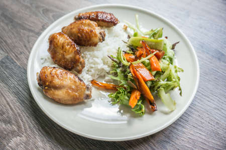 chicken grilled on a Jasmine rice with salad, selective focus 版權商用圖片