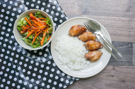 Rice and  grilled chicken with roasted carrot salad