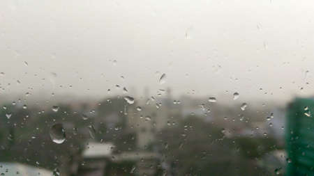 selective focus , Drops of rain on the window with city view  on background 版權商用圖片