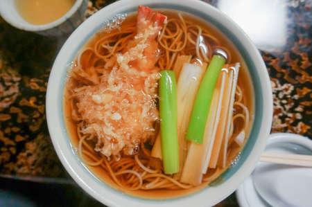 Hot buckwheat with shrimp Tempura , selective focus