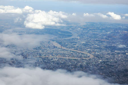 Bangkok cityscape and river view in high angle and partly cloudy. The picture was taken from the plane window. 版權商用圖片