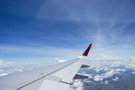 Cloud , Sky and  aircraft Wing From the air-plane window 版權商用圖片