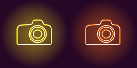 Neon icon of Yellow and Orange Photo Camera. illustration of Yellow and Orange Neon Camera consisting of neon outlines, with backlight on the dark background  イラスト・ベクター素材