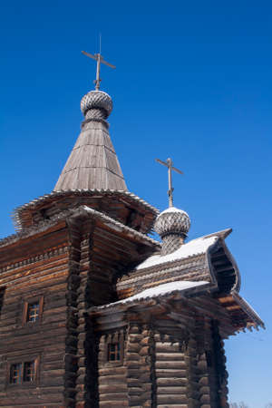 Ancient wooden architectural structure - the church of the 17th century: details, dome, roof, windows, porch, walls Stock Photo